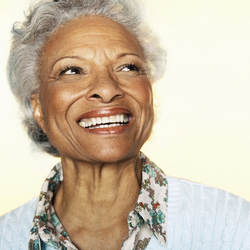Woman smiling about dental implants in Irving,TX