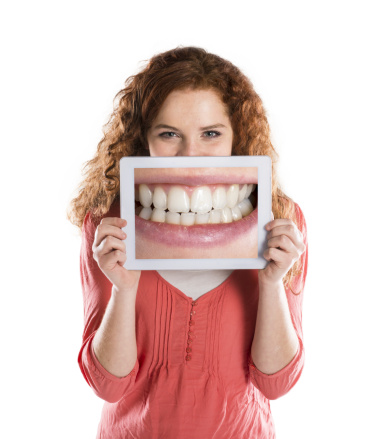 Woman smiling about her naturally looking dental implants in Irving,TX